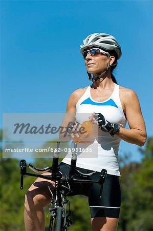 Female cyclist taking break