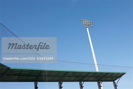 Stadium floodlights and netting