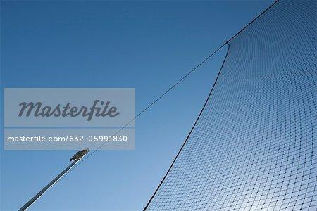 Sports net against blue sky