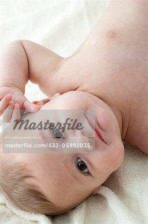 Baby boy lying on back, portrait