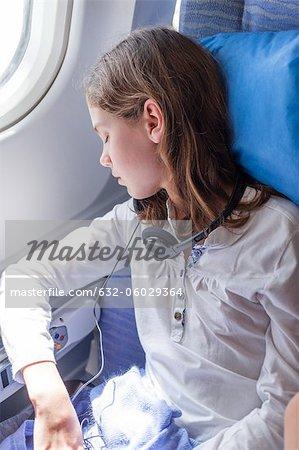 Girl sleeping on airplane