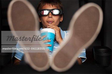 Boy enjoying 3-D movie in theater