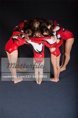 Team of gymnasts huddling