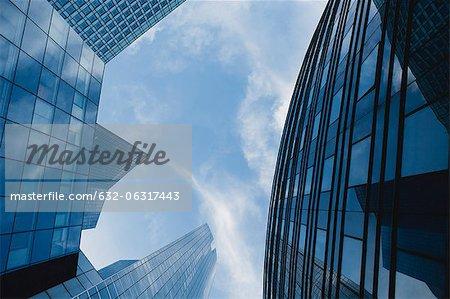 Facade of modern office buildings against sky, directly below