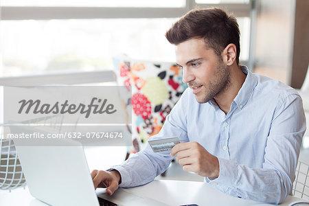 Man preparing to make online purchase using credit card