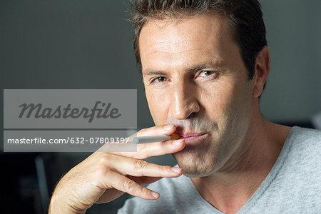 Man smoking electonic cigarette, portrait