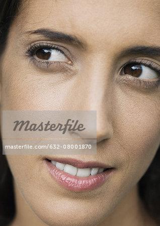 Woman looking away, close-up of face