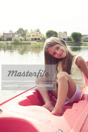 Girl kayaking on lake
