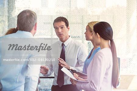 Supervisor explaining instructions to employees