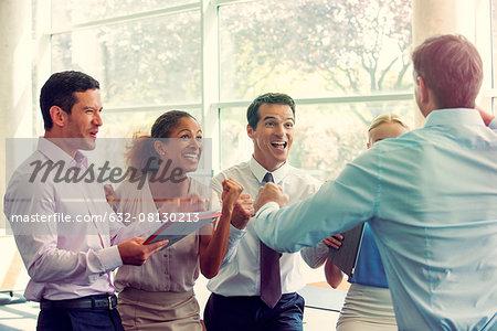 Business team members celebrating success