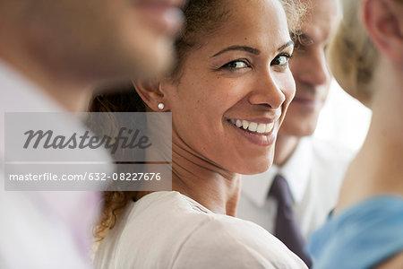 Businesswoman smiling over shoulder, portrait