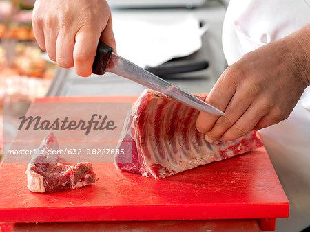 Butcher cutting meat