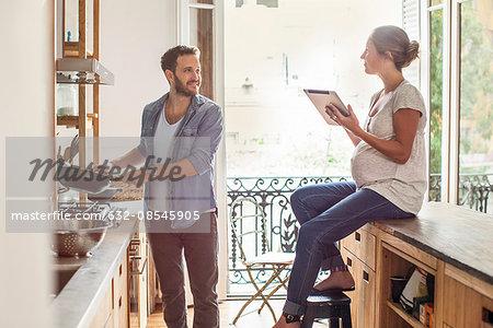 Wife looking on as husband prepares meal