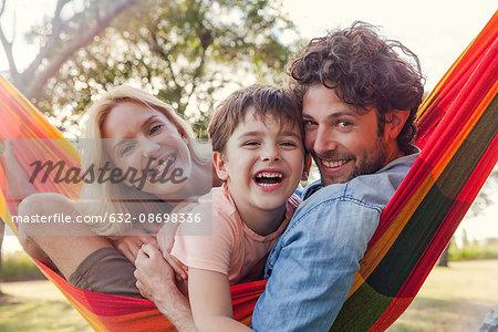 Family relaxing on hammock, portrait