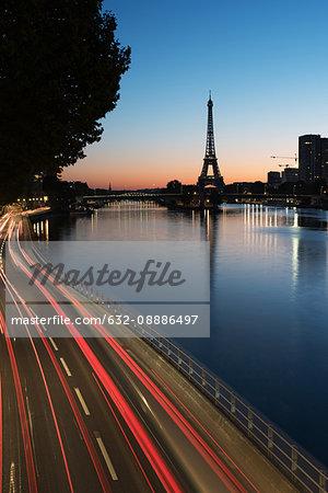 France, Paris, light trails along the Seine at twilight