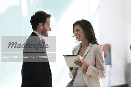 Business associates working together using digital tablet