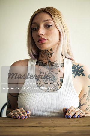 Tattooed woman with attitude, portrait