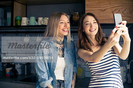 Women using smartphone to take a selfie