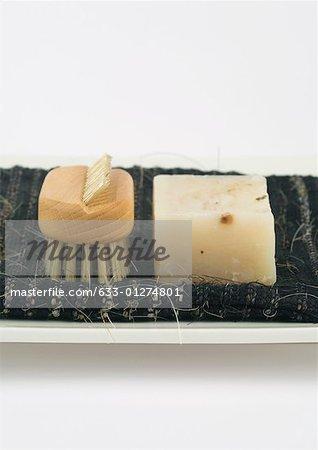 Bar of soap and bath brush