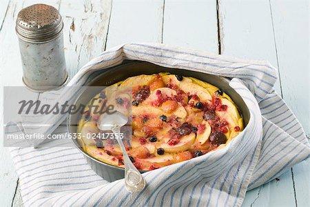 Fruit tart on rustic table