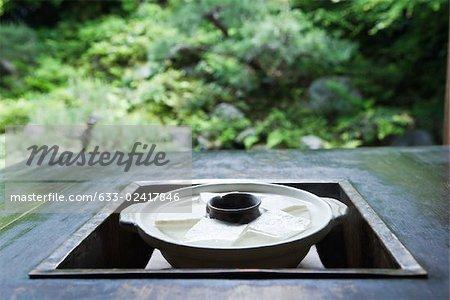 Pot of yudofu, traditional Japanese dish, in brazier