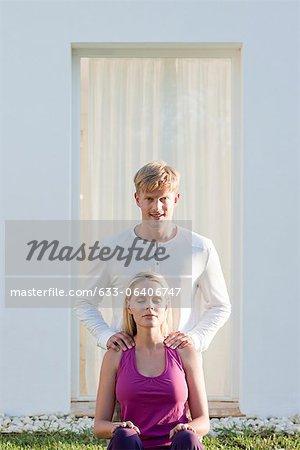 Young man giving girlfriend massage