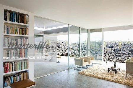 Modern living room overlooking volcanic rock