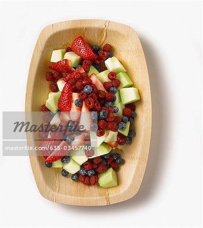 Fresh fruit salad in wooden bowl