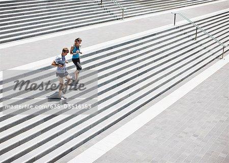 Runners running down stairs