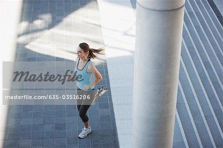 Woman running through urban setting