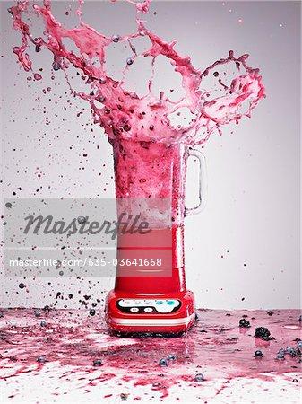 Berry juice splashing from blender