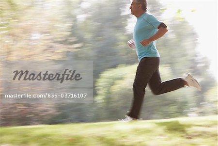 Determined man running outdoors
