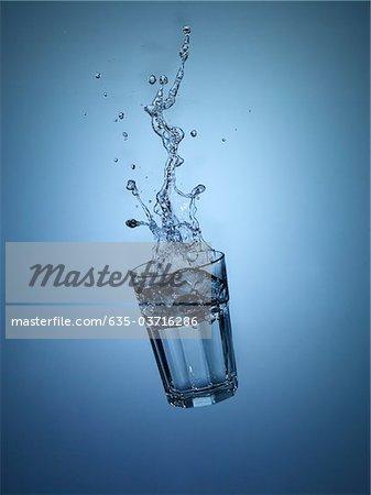 Falling glass of water