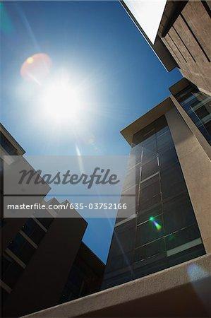 Sun shining on modern office building