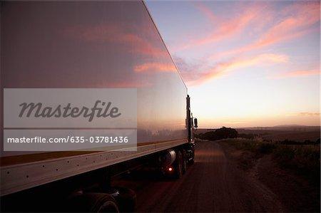 Semi-truck driving on remote road