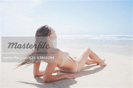 Woman sunbathing on beach