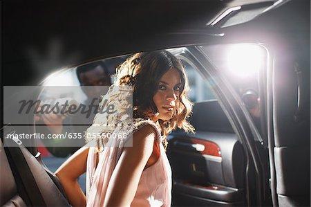 Celebrity emerging from car towards paparazzi