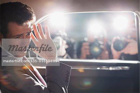 Politician shielding himself from paparazzi