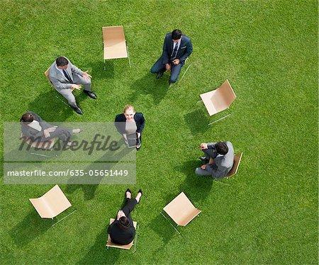 Business people having meeting outdoors