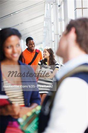 Students talking in school hallway