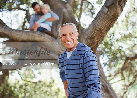 Smiling older man walking outdoors