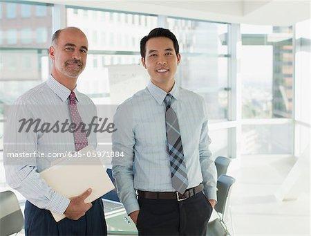 Smiling businessmen standing in office