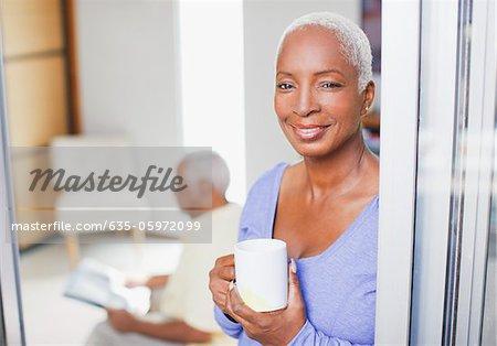 Older woman having cup of coffee