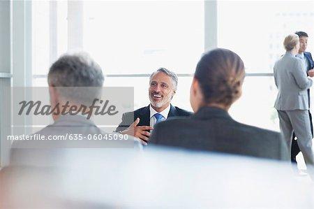 Business people talking in lobby