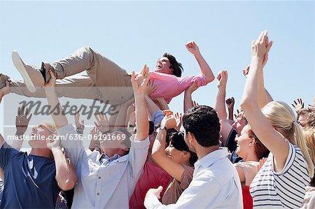 Man crowd surfing