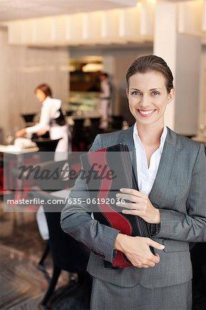 Portrait of smiling hostess in restaurant