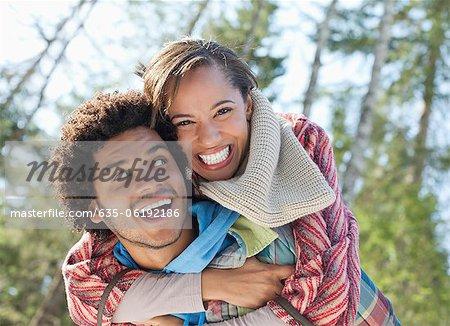 Portrait of enthusiastic couple piggybacking