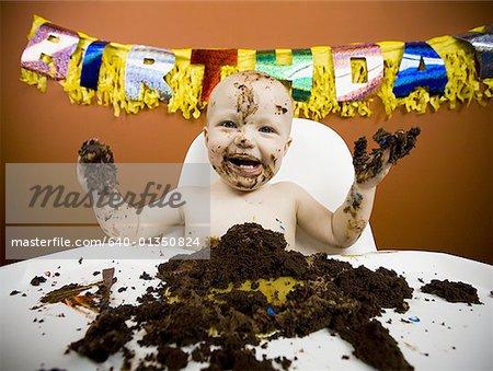 Admirable Baby Eating Birthday Cake Stock Photo Masterfile Premium Funny Birthday Cards Online Hendilapandamsfinfo