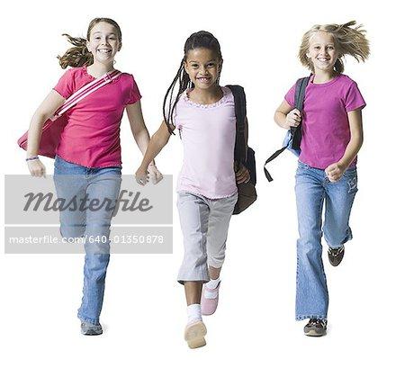 Portrait of three girls running