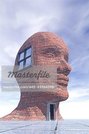 Low angle view of a brick building shaped like human head